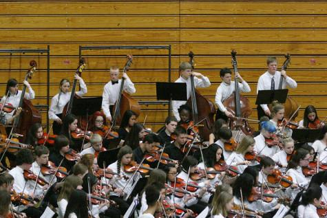 """Luminesce"" is performed by the junior high The Region Three Orchestra Festival was held Feb. 25 in the PHS gym. First and second year orchestra students along with the combined orchestra of Edgemont, Aylen and Kalles performed with the Puyallup High School orchestra.band."