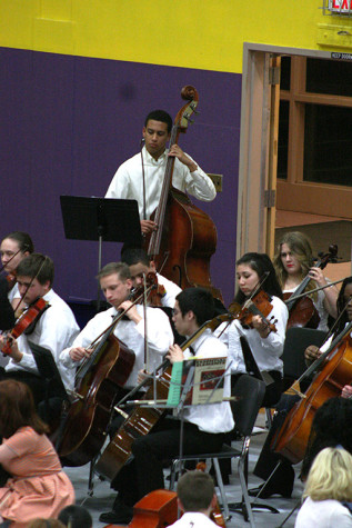"PHS orchestra members play ""Fantasia on an Original Theme."" The Region Three Orchestra Festival was held Feb. 25 in the PHS gym. First and second year orchestra students along with the combined orchestra of Edgemont, Aylen and Kalles performed with the Puyallup High School orchestra."
