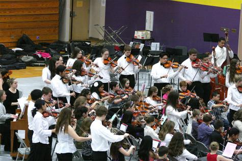"The high school band accompanies the first year band as they perform ""Ode to Joy"" together. The Region Three Orchestra Festival was held Feb. 25 in the PHS gym. First and second year orchestra students along with the combined orchestra of Edgemont, Aylen and Kalles performed with the Puyallup High School orchestra."