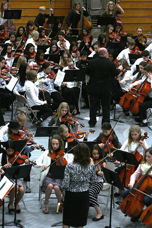 """The second year and junior high orchestras also perform """"Ode to Joy"""" with the high school and first year orchestra.The Region Three Orchestra Festival was held Feb. 25 in the PHS gym. First and second year orchestra students along with the combined orchestra of Edgemont, Aylen and Kalles performed with the Puyallup High School orchestra."""