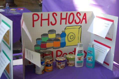 HOSA students explain that the PHS HOSA Food Pantry benefits PHS students. The Health Occupation Students of America club held their annual spring health fair March 26.