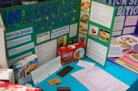 HOSA presents students with healthy snack options. The Health Occupation Students of America club held their annual spring health fair March 26.