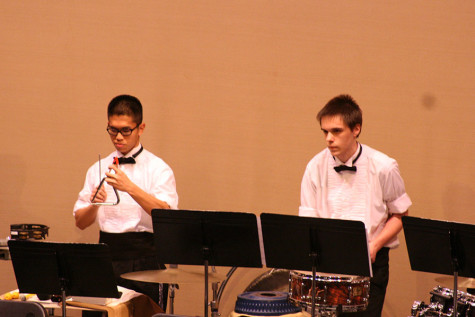 Percussionists senior Nathan Casement and junior Russell Subiel play with the band. The Percussion and Wind Ensemble along with the Jazz, Concert and Symphonic Bands performed March 23 at the band concert held in the auditorium.