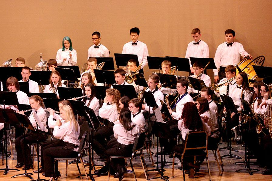 """The Symphonic Band performs """"Scenes of Wonder"""". The Percussion and Wind Ensemble along with the Jazz, Concert and Symphonic Bands performed March 23 at the band concert held in the auditorium."""