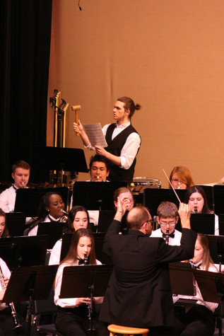"Junior Brandon Sujka plays the chimes in ""Scenes of Wonder"". The Percussion and Wind Ensemble along with the Jazz, Concert and Symphonic Bands performed March 23 at the band concert held in the auditorium."