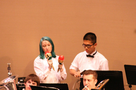 Junior percussionists Carlye Parker and Russell Subiel play with the band. The Percussion and Wind Ensemble along with the Jazz, Concert and Symphonic Bands performed March 23 at the band concert held in the auditorium.