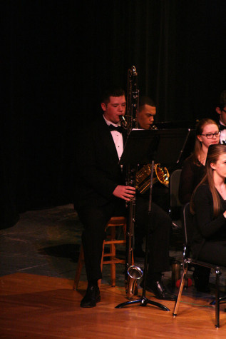 Junior Jared Williams plays the contra bass clarinet in the Wind Ensemble. The Percussion and Wind Ensemble along with the Jazz, Concert and Symphonic Bands performed March 23 at the band concert held in the auditorium.