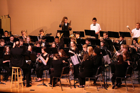 "The Wind Ensemble plays the third movement of their piece, ""Second Suite in F"". The Percussion and Wind Ensemble along with the Jazz, Concert and Symphonic Bands performed March 23 at the band concert held in the auditorium."