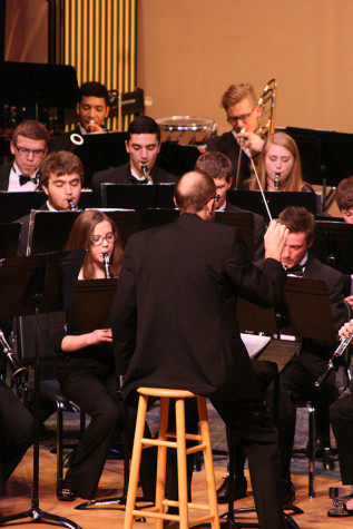 Band director Eric Ryan leads the Wind Ensemble. The Percussion and Wind Ensemble along with the Jazz, Concert and Symphonic Bands performed March 23 at the band concert held in the auditorium.