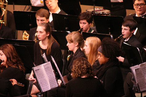 Clarinet and flute players intently watch Ryan. The Percussion and Wind Ensemble along with the Jazz, Concert and Symphonic Bands performed March 23 at the band concert held in the auditorium.