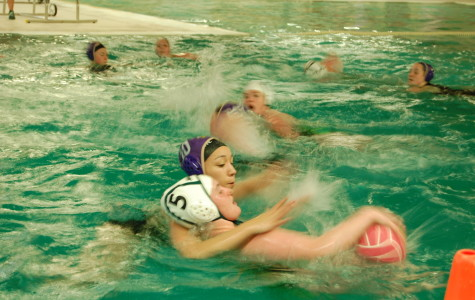 Ami Kiuchi guards an Emerald Ridge girl as she attempts to pass the ball to a teammate. The PHS girls Water Polo team went up against Emerald Ridge April 22. Puyallup won with a final score of 9-0.