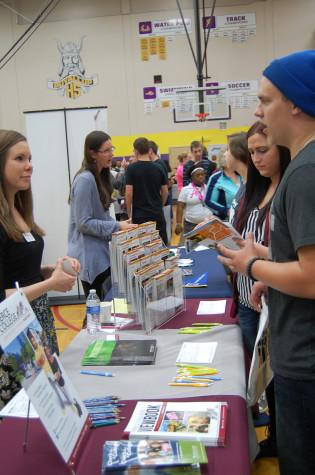 Students talk to the Pierce College representative. PHS held its annual Future Fair April 9 during third period. The fair presented students with a variety of colleges, universities, military representatives, employment opportunities and service organizations.