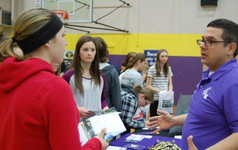 The University of Washington representative explains scholarship options. PHS held its annual Future Fair April 9 during third period. The fair presented students with a variety of colleges, universities, military representatives, employment opportunities and service organizations.