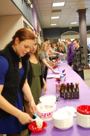 Seniors Katie Hawley and Sierra Molmen serve students ice cream and various toppings.  Leadership rewarded students that have a G.P.A. of 3.0 or higher with ice cream sundaes during both lunches April 29.