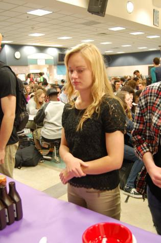 Sophomore Emily Pierson patiently waits to receive her G.P.A. sundae. Leadership rewarded students that have a G.P.A. of 3.0 or higher with ice cream sundaes during both lunches April 29.