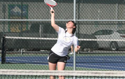 Senior Anna Flury serves the ball to her opponent. The girls tennis team faced Graham-Kapowsin High School March 26 and lost with a score of 1-4.