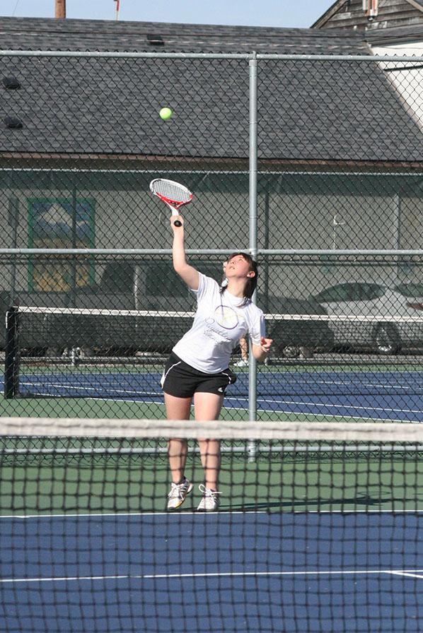 Senior+Anna+Flury+serves+the+ball+to+her+opponent.+The+girls+tennis+team+faced+Graham-Kapowsin+High+School+March+26+and+lost+with+a+score+of+1-4.