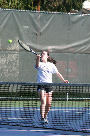 Sophomore Jessi Oyama hits the ball off of a serve from Graham-Kapowsin. The girls tennis team faced Graham-Kapowsin High School March 26 and lost with a score of 1-4.
