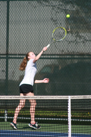 Sophomore Scotney Carlson serves the ball to Graham- Kapowsin. The girls tennis team faced Graham-Kapowsin High School March 26 and lost with a score of 1-4.