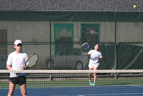The doubles team including senior Khiarah Eddington and junior Jordan Kim prepare to receive a serve from the their opponents. The girls tennis team faced Graham-Kapowsin High School March 26 and lost with a score of 1-4.