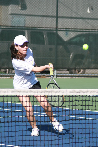 Senior Khiarah Eddington hits the ball as it comes from the opponent's side. The girls tennis team faced Graham-Kapowsin High School March 26 and lost with a score of 1-4.