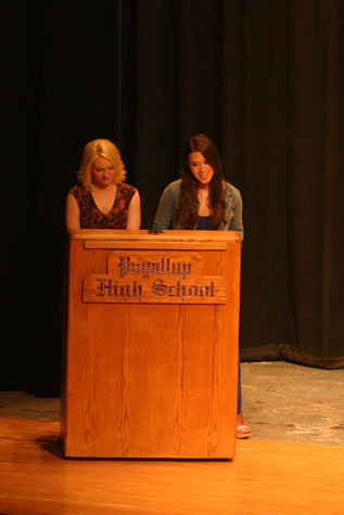 Emcees senior Keely Connolly and senior Celeste Grinnell introduce the performers. The Viking Varieties talent show was held April 9 in the auditorium.