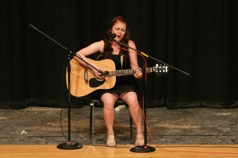 Senior Ashley Becker performs an original song while playing the guitar. The Viking Varieties talent show was held April 9 in the auditorium.