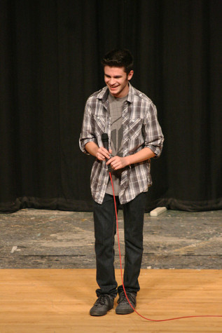 "Sophomore Riley Harasymczvk performs Uncle Kracker's well-known song, ""Follow Me."" The Viking Varieties talent show was held April 9 in the auditorium."