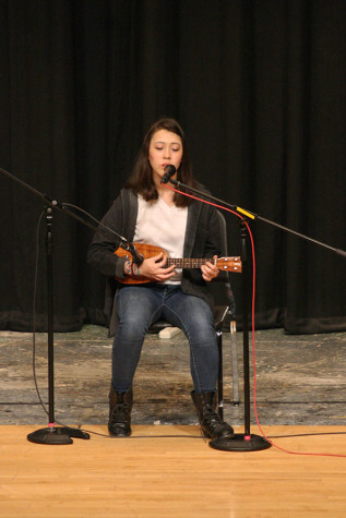 "Junior Olivia Grinnell performs Vance Joy's ""Riptide,"" while playing the ukulele. The Viking Varieties talent show was held April 9 in the auditorium."