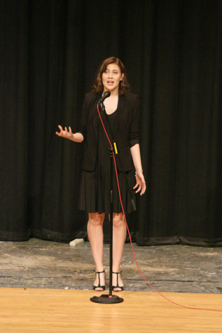 Senior Danielle Locken recites an original spoken word poem about her guitar. The Viking Varieties talent show was held April 9 in the auditorium.