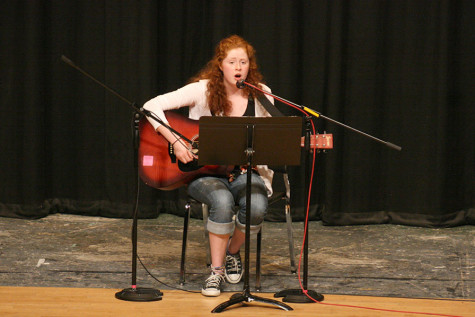 Sophomore Bailee Doman showcases her talent by playing the guitar and singing. The Viking Varieties talent show was held April 9 in the auditorium.