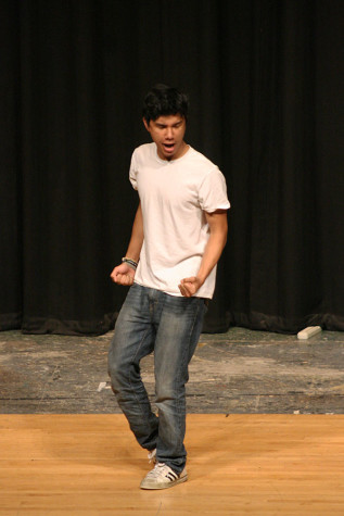 Junior Antinee Eteaki enters on the stage before his partner, junior Gerardo Zaragoza and begins dancing. The Viking Varieties talent show was held April 9 in the auditorium.