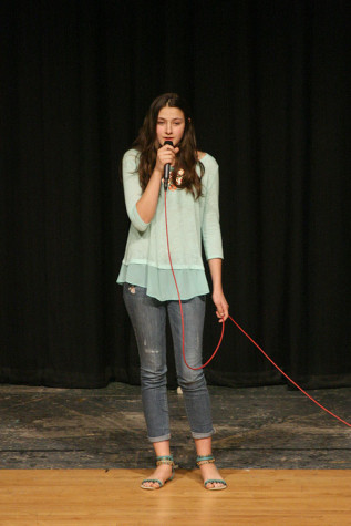 """Junior Shaylyn Smith sings the song """"Dream a Little Dream of Me."""" The Viking Varieties talent show was held April 9 in the auditorium."""