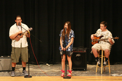 Sophomore Connor Fredericks, Sophomore Kaylee Setterfield and Junior Sean Zuehlsdorff perform as Fredericks plays the bass, Setterfield sings and Zuehlsdorff plays the ukulele. The Viking Varieties talent show was held April 9 in the auditorium.