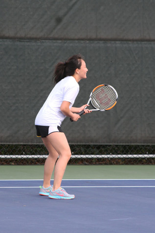 Junior Kaylee Oliva anticipates a serve from her opponent. The girls tennis team played against Spanaway Lake High School April 14 and won with a score of 4-1.