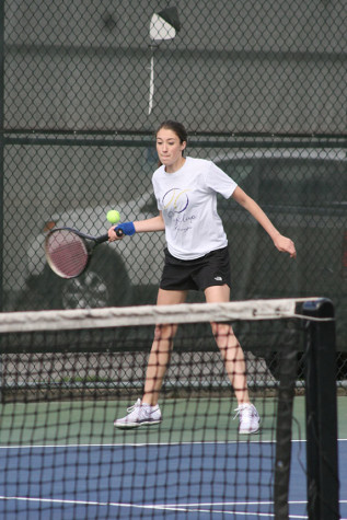 Sophomore Miranda Gooler hits the ball off of a serve from a Spanaway Lake player. The girls tennis team played against Spanaway Lake High School April 14 and won with a score of 4-1.