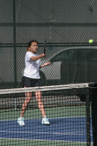 Junior Jasmine Sunheng hits the ball back to her opponent. The girls tennis team played against Spanaway Lake High School April 14 and won with a score of 4-1.