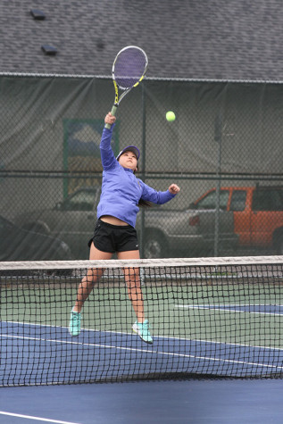 •Junior Jordan Kim strikes back in a rally against a Sentinel doubles team, with Senior Khiarah Eddington as her partner. The girls tennis team played against Spanaway Lake High School April 14 and won with a score of 4-1.