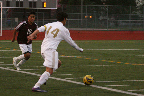 Senior Jonathan Contreras gets past a Bethel defender. The boys soccer team won against Bethel High School with a score of 7-0 April 21.