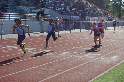 "The heated 4X200m race between Puyallup, Rogers and Emerald Ridge brought much attention across Sparks Stadium. ""It was a very competitive race because they are our rivals,"" senior Kendra Windom said. PHS Track and Field took first against Emerald Ridge and Rogers May 7."