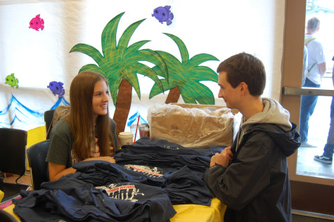 Sophomore Hannah Custer gives sophomore Evan Crady a free T-shirt. HOSA held their last blood drive of the 2015 school year on June 1.