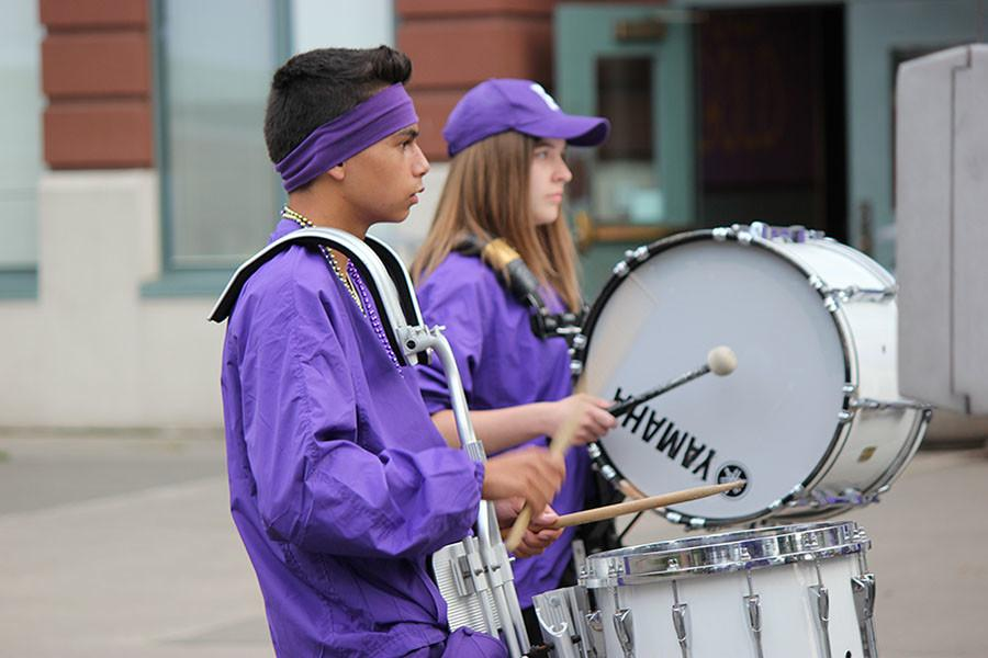 Junior Luke Maghirang practices for drum line for the march to the match on 9/18/15.