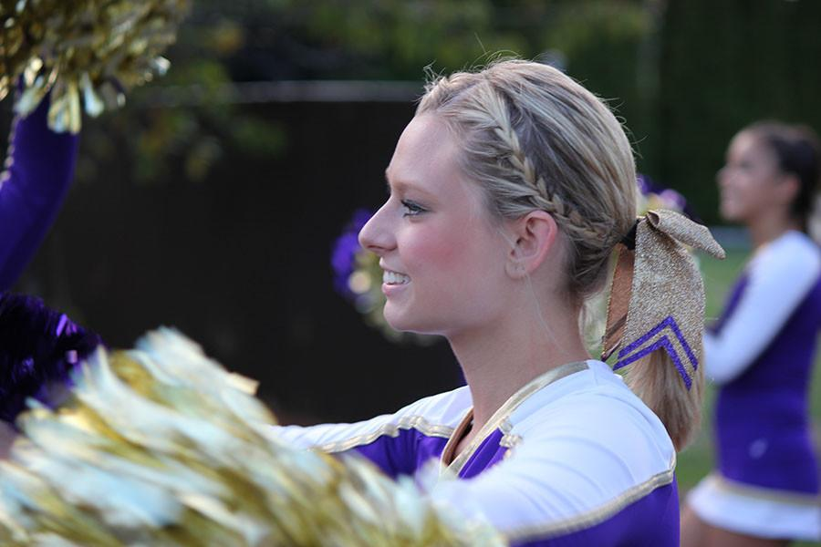 Senior Alexis Wakefield a cheerleader for PHS marches to the match on 9/18/15.