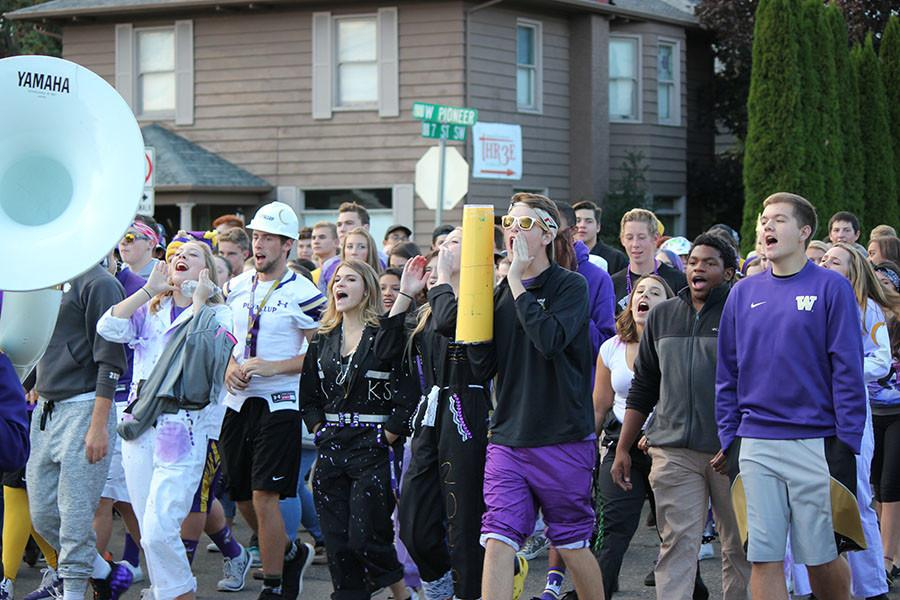 The student body marches to the Varsity football game on 9/18/15.