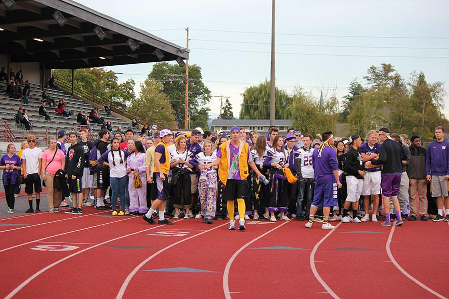 Senior Nick Fraser leads students from the march to the match on 9/18/15.