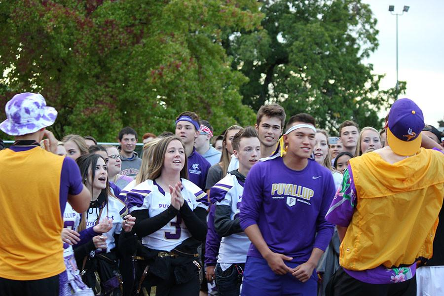 The student section marches to the match on 9/18/15.