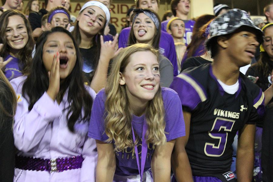 Senior Apryl Johnson cheers for the Vikings at the game on 9/18/15.