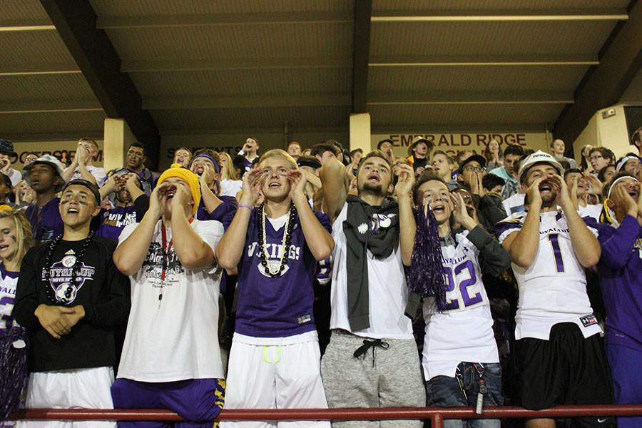 The student section cheers for the Vikings at the football game on 9/18/15.