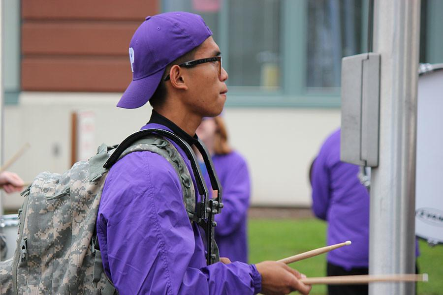 Senior Russell Subiel practices snare for the march to the match on 9/18/15