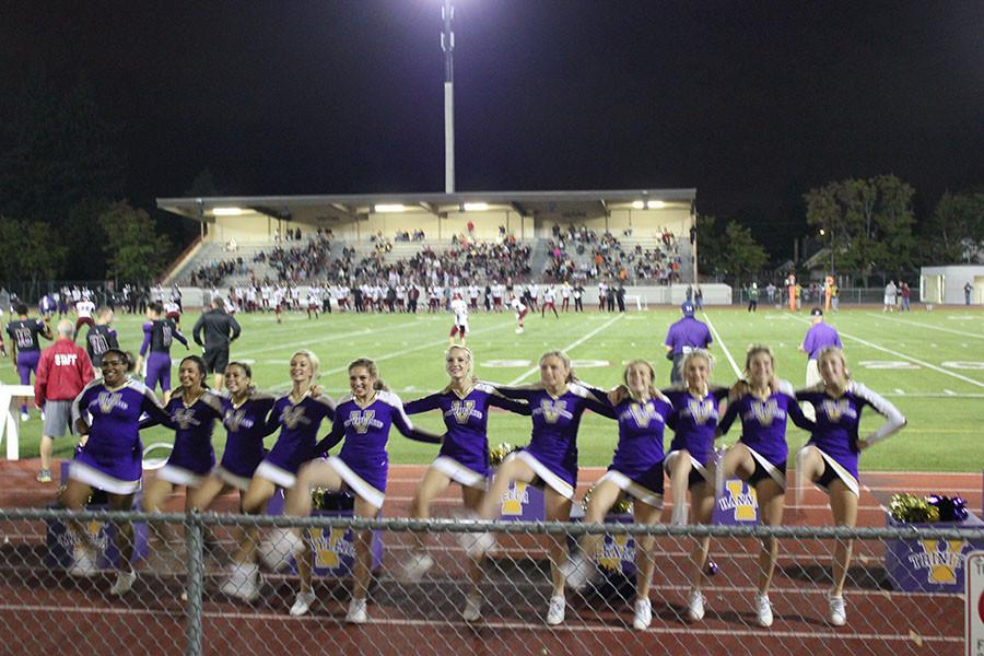 PHS Cheerleaders doing the kick line at the home football game on 9/18/15.